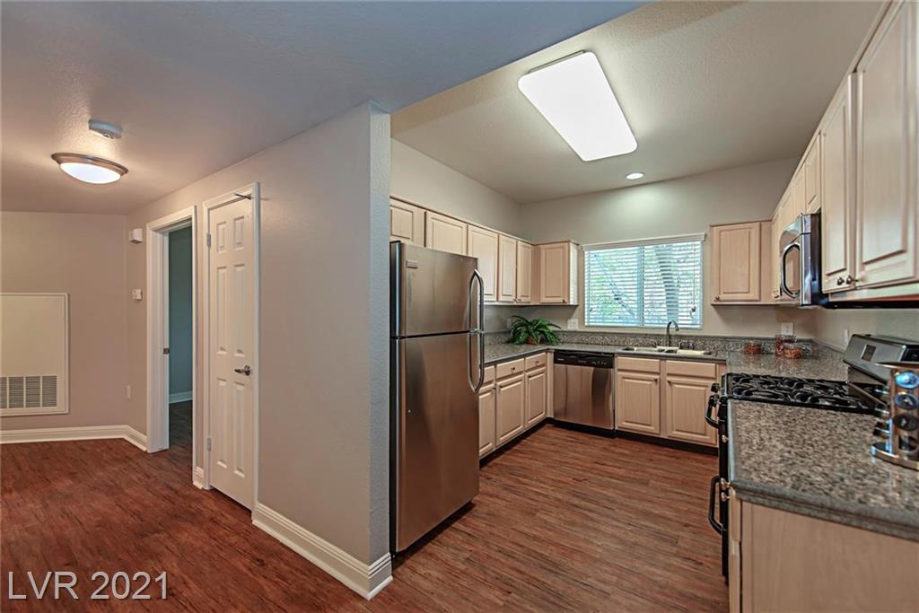 GORGEOUS AND RECENTLY REMODELED, STAINLESS STEEL APPLIANCES, VINYL-WOOD PLANKED FLOORING THROUGHOUT, TILE BATHROOMS, GRANITE COUNTER TOPS, WOODEN BLINDS WINDOW TREATMENTS, LARGE 2 CAR ATTACHED GARAGE. GARAGE FLOORS FINISHED AND PAINTED, BEAUTIFUL, MATURE LANDSCAPING THROUGHOUT, NICE PRIVATE POOL VIEWS. THIS UNIT WILL NOT DISAPPOINT!!!