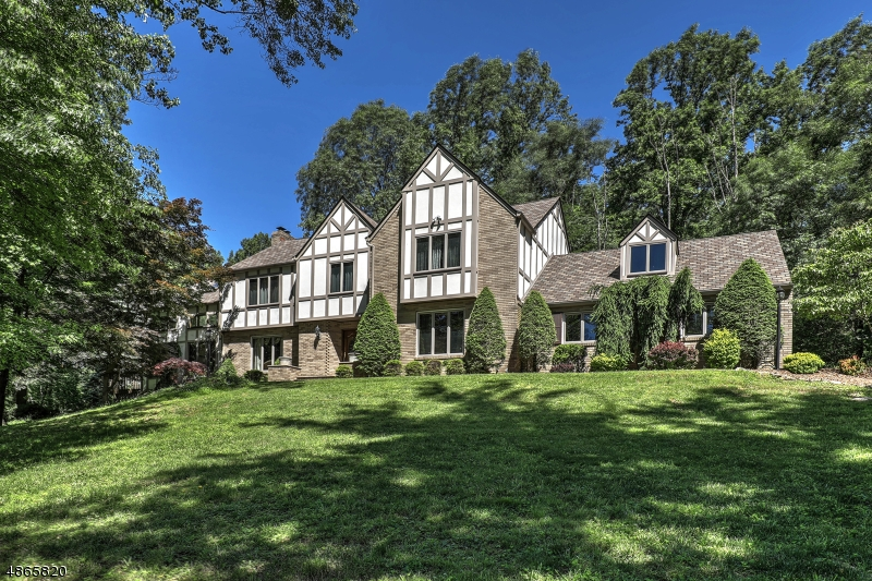 Regal Tudor Residence w/2012 quality updating presents 4 BR, 2.5 baths, resort-style Sylvan gunite pool, expansive paver patios &  deck embraced by mature trees, landscaping & pond sited on 3+ cul-de- sac acs. Highlights of this 3550+ sq home incl: oak, tile & granite flrs, masonry FRPL, 6-panel & French doors, detailed woodwork & molding, updated baths, beam-ceil LR w/stone wall wood burn FRPL, DR w/bay window, soaring cathedral great rm showcased w/3 window walls, sliding glass doors opening up to nature, sky-lights, balcony, expansive billiards rm w/coffered ceiling fitted w/wood-work & flooring w/built-in oak bar, chef's kitch w/center isle/breakfast bar opens to patio. Grand master suite w/updated spa bath, soak/tub, radiant heat granite flrs, furniture caliber 2-sink vanity, 3 additional BR, FB & office