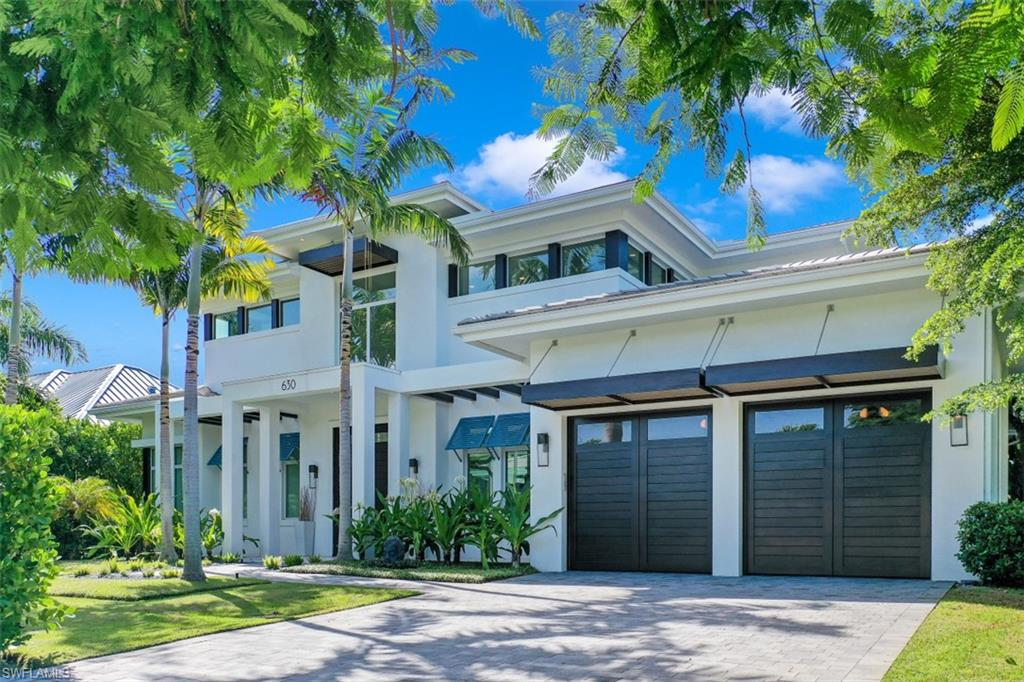 This Old Naples custom coastal contemporary home exudes class, attention to detail and the best living Naples has to offer. Completed in 2015, this 4 bedroom plus den/office, 4 full bath/2 half bath, 3 car garage custom home with rear alley access boasts over 4,400 square feet of generous space. The features of this home bring nature and water into the interiors for a relaxing and elegant lifestyle. The custom glass stair case, interior and exterior linear fireplaces, outdoor pool/spa area, and outdoor teak shower are just a few features that show the generous care and investment made into the construction of this home. Situated on an oversize lot and quiet street with little to no thru traffic, and close proximity to the beach, it is easy to see the great value in this property. Completed in collaboration with Milestone Builders, and Jen Zella with CID Design Group. Enjoy all Old Naples has to offer in this incredible home.