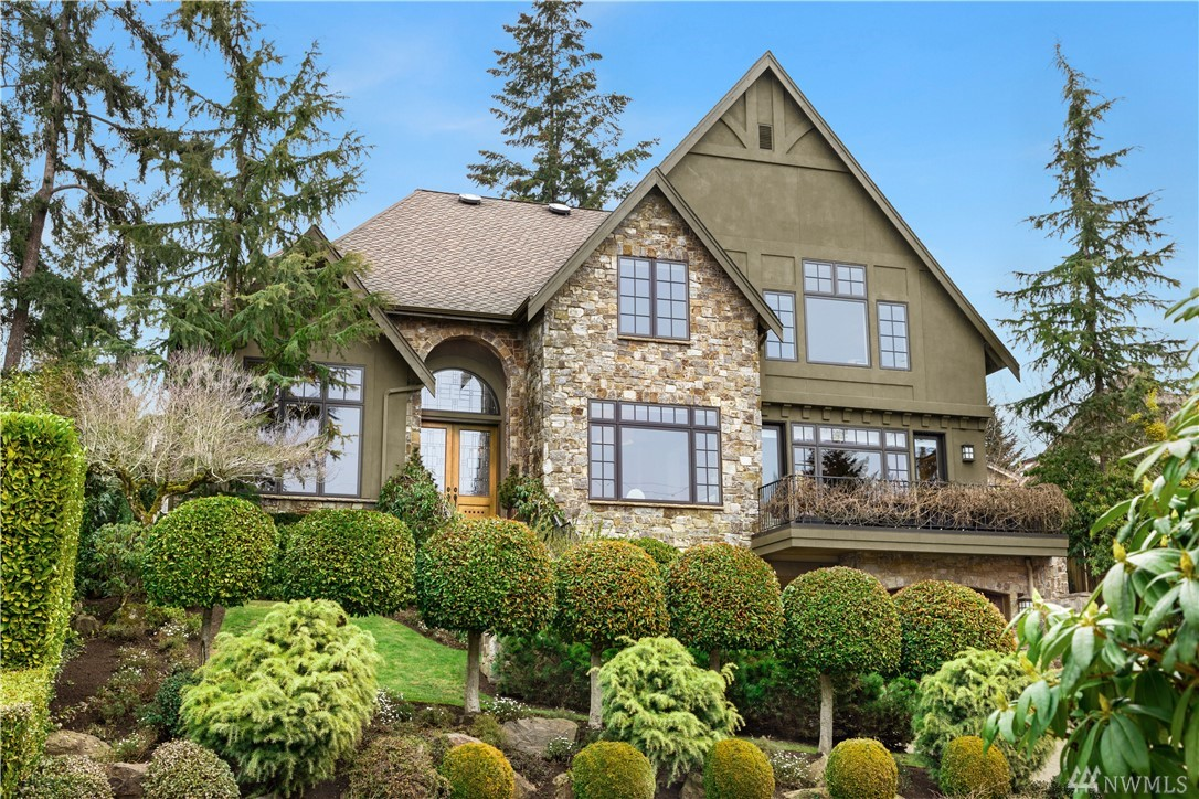 Rich elegant finishes adorn this celebrated Steven D Smith design. Library/Study w/fireside seating. Main level Guest/Flex Room. Lower level Recreation Room w/ Refreshment Center, Wine Cellar, Exercise Room & Theater! Gracious Master Suite w/big LAKE VIEWS! Great Room opens to elevated sun terrace. Glorious backyard Great Room w/fireplace, chandelier lighting & privacy. Professionally landscaped grounds inc stone pillar entry waterfall, handset pavers front driveway & rear terrace. Many extras!