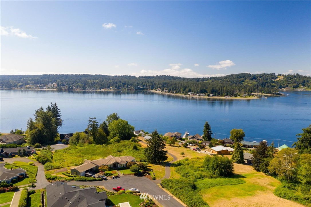 Overlooking Hales passage and Fox Island, this quality custom view home in Cromwell Point Estates has been meticulously maintained and beautifully upgraded. Tucked at the end of a cul de sac and backed by a greenbelt and lush mature landscaping,  you can enjoy privacy from both front and back decks, lovely water features and fire pit. New roof in 2018, new gas furnace and water heater in August. Move right in and enjoy amazing views, style, and location! Welcome Home!