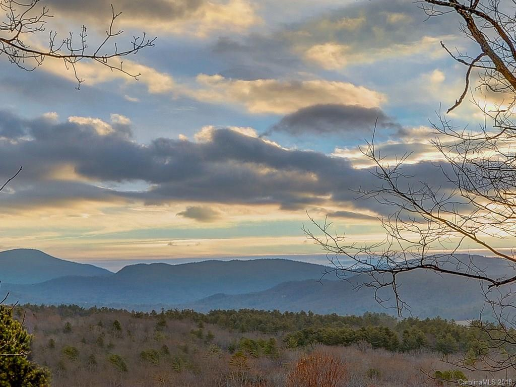 Phenomenal views of Cane Creek Valley and Burney Mountain, southern exposure, paved access road, underground utilities, driveway already cut in. Elegant subdivision setting. 5.85 Acres. Best view, best value in South Asheville! Come see for yourself.