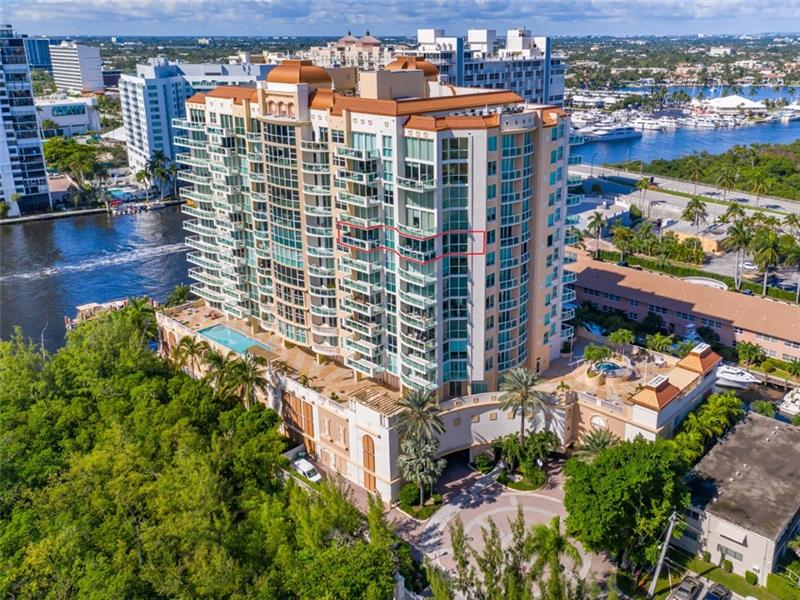 This modern coastal design corner condo offers oversized open living area with reflective ceilings to amplify views of Bonnet House gardens, Intracoastal and the ocean; Gourmet Kitchen with Subzero & Wolf appliances, custom pantry; concrete epoxy floors, two oversized  balconies; contemporary master bathroom - luxury lighted oversized LED Vanity Mirror, designer bathtub, bidet, modern electric fireplace; grande master suite; customized closets. 3 block walk to the beach, shopping & fine dining.  Le Club International Condo is a luxury-boutique condominium with elevator entry into your private foyer, concierge, state-of-the-art fitness room, and heated pool.  Laundry room with sink. Remote control blinds. High-end lighting; 2 garage spaces. Marina with 60' boat slip available. Pet Friendly!