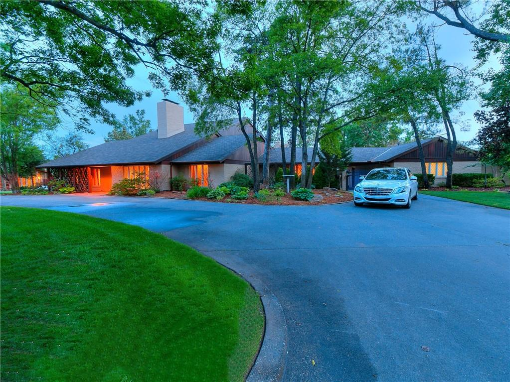 Located on one of the most prestigious streets Nichols Hills/Penshurst has to offer and only moments away from the Oklahoma City Golf and Country Club. This Mid-Century gem situated on a large corner lot surrounded by mature trees and immaculate landscaping is truly one of a kind. Experience the breathtaking backyard oasis equipped with a fully tiled pool and waterfall, outdoor bar/cabana with its own pool bath, fire-pit, and basketball court. Countless high-end updates have gone into this home including all new Pella glass doors and windows throughout, all new pool equipment, Signature Ralph Lauren fabric walls, imported Italian glass ceiling, hickory hardwood floors, Sherle Wagner faucets and more. Grand living spaces offering tons of natural light make this home an entertainer's paradise. Spacious master retreat with vaulted ceiling and ample closet space as well as a sauna bed. Meticulous design and care throughout the home make this one you don't want to miss.