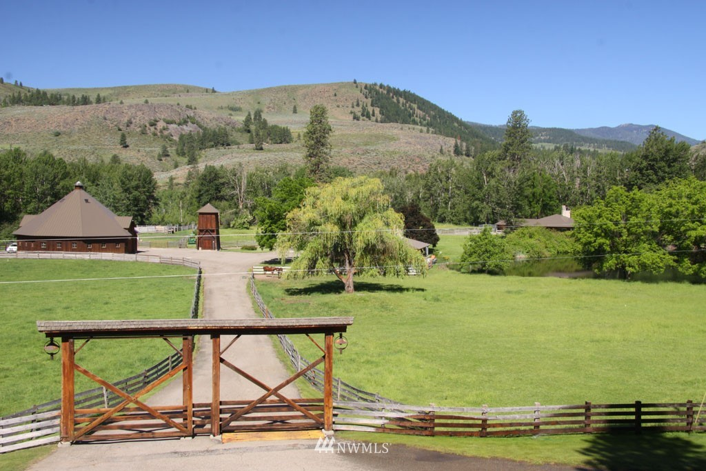 """The historic Wagner Ranch, a legacy property, 328 deeded-acres, 1.6 miles Chewuch riverfront, Ramsey Creek, fresh water lake, magnificent views, two-lakefront homes; main residence, guest house or managers home.  Each locally milled & hand-crafted using artful and historic elements of large timbers & Western rock, stone fireplaces, extensive decks & patios. An artistic barn """"One of Kind"""" country bunkhouse & corrals, irrigated pasture, Ponderosa pine forest, borders State & Federal Land.  An incredible place to live, love and leave a legacy! (*Interior photos coming soon.)"""