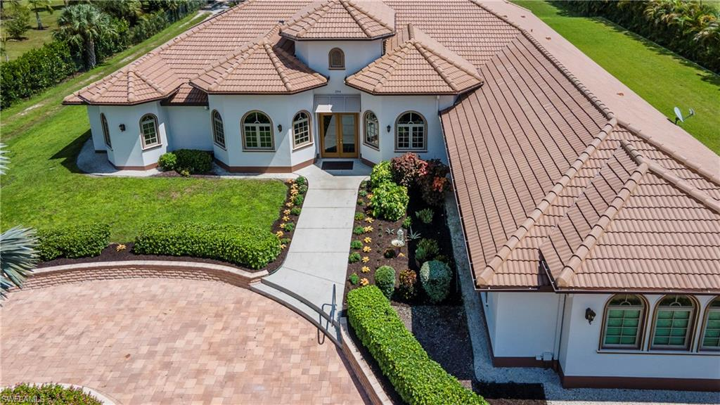 No comparables exist for this custom-built estate home in Logan Woods built with a specially formulated super-brick (Aercon) that is fireproof, bulletproof, pest-resistant, and hurricane-proof. No expense has been spared creating this masterpiece built to last many lifetimes and which offers private secure luxury living in Naples, FL. The location offers 2.52 acres of manicured lawns and gardens yet is within 7 miles of award-winning beaches, 2 miles to grocery shopping and a major hospital, and within 4 miles of a major Naples shopping/dining corridor. A 1,000-gallon buried propane tank powers a 45 kilowatt whole-house backup generator if needed. The home's interior offers a chef's kitchen with Wolf and Sub-zero appliances, decorative porcelain tile floors, furniture quality doors and window trims, reverse-osmosis water system, 3-pane Pella impact windows, maple cabinetry, and much much more.  The massive screened lanai encloses a custom pool with integrated spa, a full outdoor kitchen with grill and refrigerator, and a manicured garden with no noise from pumps or machinery. Come live a peaceful and active lifestyle in SW Florida in an ultra-secure luxury home you can be proud of.