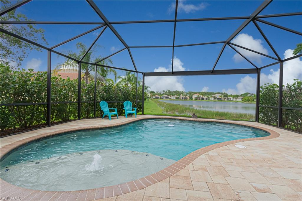 """THIS GORGEOUS MOVE IN READY """"JASMINE"""" MODEL HAS EVERLASTING VIEWS OF THE LAKE! EVEN COMES WITH A SALTWATER HEATED POOL AND OVERSIZED LANAI WITH PICTURE WINDOW SCREEN! Home was upgraded by the builder when built. Tile floors on a diagonal throughout all main living areas of the first floor. Offers a Bedroom and Full Bath on 1st Floor. Kitchen has a walk in pantry, Granite Countertops, Tile Backsplash, Wood Cabinets and Stainless Appliances. With almost 2,700 square feet of living space this 5 bedrooms / 3 Full bath home is perfectly laid out. A/C approx 2 years old. New Salt Cell for Pool. Botanica Lakes is one of SW Florida's most exciting new real estate communities offering an incredible lifestyle and a great value, too! Botanica Lakes features over 100 acres of open space and natural preserves and 32 acres of lakes in a prime location off the Treeline Corridor. Botanica Lakes in SWFL truly has something for everyone."""