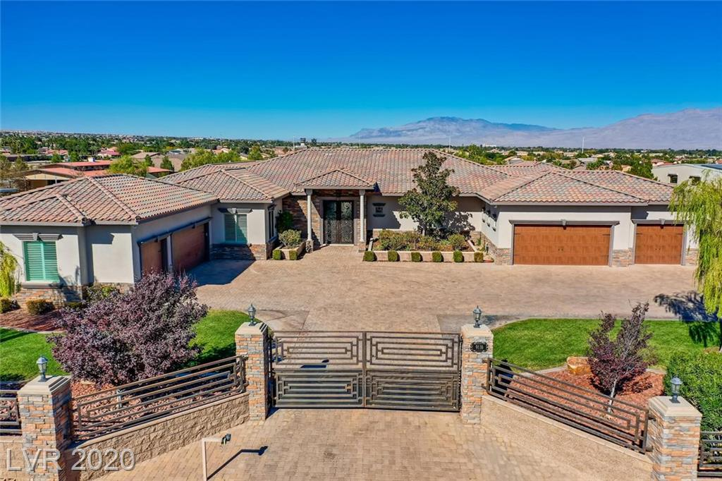One of a kind Equestrian Estate in the Northwest. Over 6000SF living space + 900SF Casita on over an acre, adjacent to beautiful Equestrian property, which includes 6 stall barn, feed & tack room, 2 large corrals, separate gated entrance & 16 cameras. Main house has 4 spacious bedrooms, all with full baths & w/in closets. Great Room is adjacent to bar w/climate-controlled wine room, and opens to beautiful island kitchen w/custom cherrywood cabinets, professional grade Kitchen Aid stainless appliances, 8 burner gas stove w/double ovens, double dishwashers & walk-in pantry. Main house includes theater room, game room, separate wing with 2 bedrooms + common area. Formal Dining Room w/built-in buffet. 12' Ceilings, crown molding & plantation shutters throughout. Detached Casita includes living/dining area + kitchenette + bed + bath. Spacious backyard w/20x42 pool/spa, sport court, koi pond, outdoor kitchen, garden, fruit & citrus trees. Security cameras & fire sprinklers included.