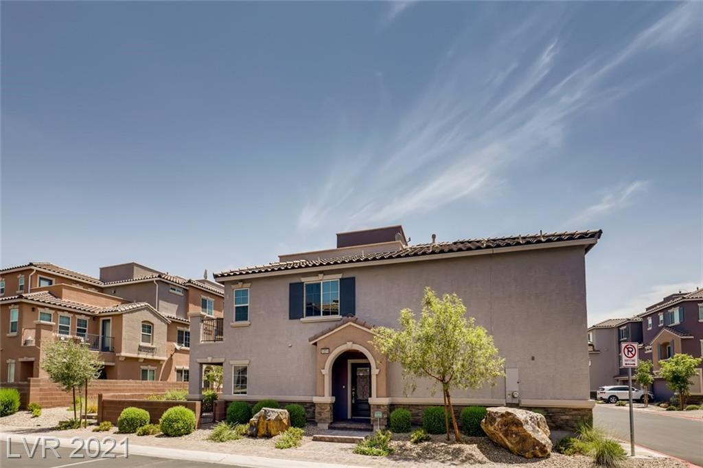 3-year-old Townhome located in a gated community within Moutain's Edge. The community is equipped with a community pool, spa, and exercise room. Seller put in over 30k while designing the home. Shatterproof windows,  5.1 Dolby surround sound speaker system throughout, custom shelving in Primary custom and garage, sink and folding station in the laundry room, canned lighting on rooftop deck, custom shades, recessed lighting, and so much more. This home is perfect for entertaining with plenty of space to host. Come preview today and fall in love with your new home.