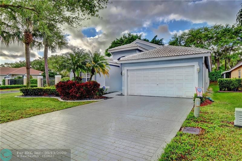Beautifully maintained 3/2 corner lot home in sought after gated Lakes at Parkland. Zoned for Stoneman Douglas HS. This single story home features: new 2018 A/C, accordion shutters, updated eat-in kitchen w/SS appliances, decorative backsplash & granite counters, laminate floors in 1 guest room, tile floors in living areas, vaulted ceilings, family room, spacious master w/His & Her walk-in closets, updated master w/dual sinks, laundry room w/storage, pavered patio and fenced-in backyard. Community boasts large pool with a cabana & landscaped/gated entry. Lawn service (front & back) included in quarterly maintenance fee. Close to shopping, dining and Sawgrass Expressway.