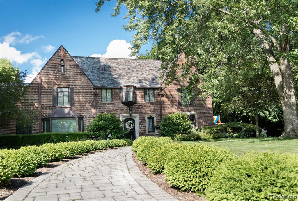 """Own this rare Palmer Woods gem!The Fisher Mansion is a stately, character-filled 1925 English Tudor with 3 stories, a slate roof, some newer windows, central air and is nestled on a tree lined street in the middle of a beautiful large lot. Its a lovely mix of original charm and updates with Mahogany Wood paneled walls and floors, original """"ice box"""" in the kitchen paired with updated stainless appliances, convenient second floor laundry, updated bathrooms and custom tiled first floor lavatory. Host a summer party on the patio with outdoor grilling area, custom basketball court, playscape and Putting Green. Soak up the sun and enjoy the sounds of birds chirping while relaxing in the air conditioned sunroom.Work from home in the stately wood paneled library/office with lovely original built-ins and elevator. Host the next holiday in the formal dining which can seat 12 comfortably.This stately home features a second floor family room and spacious master suite w/full bath/custom closets."""