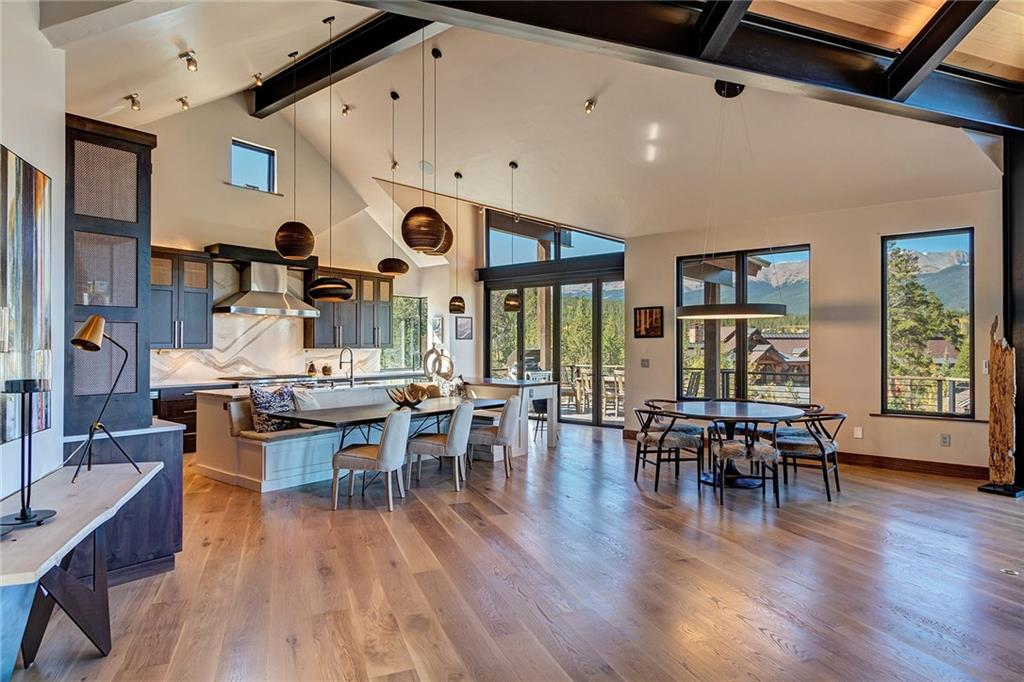 Ten Mile Range, Breckenridge ski slopes, golf course or lake views? All are yours in this New Modern Masterpiece. Expand your living space into the great outdoors by opening up walls of glass in the great room & kitchen. Fire feature on the wrap-around upper deck and on the lower-level patio. Chef's kitchen complete with 2 dishwashers, Subzero fridge/freezer, Wolf stove, 2 sinks and a walnut breakfast bar. Spa-like bathrooms, wine room, bar area, bunk room, game area, and an oversize shower.