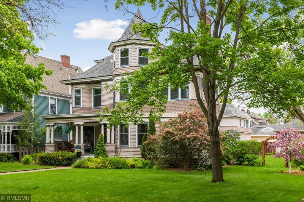 This gorgeous Queen Anne Victorian home is situated on a double lot on a quiet tree-lined street - 940 Portland Avenue