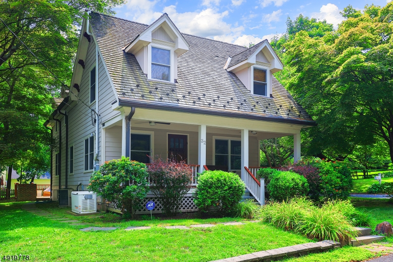 """Totally rebuilt/renoed in 2006, this is your chance for a YOUNG sunlit colonial in one of Basking Ridge's prized in-town neighborhoods. Just 3 blocks to town/school/restaurants/park & train! A granite & stainless Kitchen with center island & walk-in pantry is the heart of the home. Enjoy entertaining in Living & Dining Rms filled with natural light & trimmed with a window seat & custom moldings. Cherish gentle summer days on the rocking chair front Porch or al fresco dining on the Deck. 3 large BRs on the 2nd fl all have big closets including an En Suite Master with walk in closet. Flexible fl plan - 1st fl BR that could be an Office/Den. Finished BSMT with Rec Rm & half Bath. Hardwood floors, new windows, cedar shake roof, copper gutters, Hardiplank siding, """"whole house"""" generator, alarm, FIOS, & much more!"""