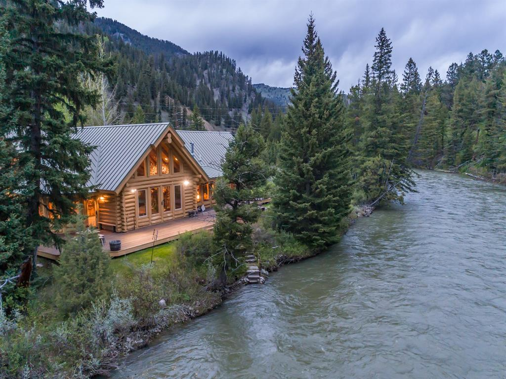This is Big Sky's finest fishing property, just steps from the Gallatin's world class fly-fishing. This section of river features excellent fishing opportunities, where one can fish to rising trout and match the hatch from the property. Entertain and enjoy the splendor of the Gallatin from this 2,234 sf wrap-around deck.  Surrounded by alpine splendor and natural beauty this 5.32 acre riverfront property is one of a kind. A true legacy property, the custom log cabin is 3,200 sf featuring a river-rock fireplace in the open concept great room with vaulted ceilings, logs from western Montana, views of the river from nearly every room plus amazing outdoor spaces to entertain. Additional living space/caretakers quarters above the detached garage. The property features a riverside recreation cabin the kids will love. The property boasts 990 feet of river frontage where boats and kayaks can be launched from the property for a leisurely float down to Deer Creek. 15 minutes to Big Sky Resort.