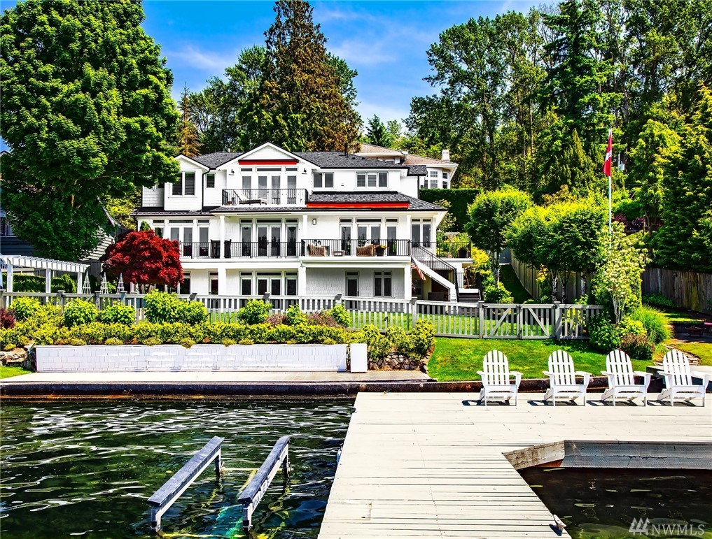 Waterfront living on Pleasure Point! Fabulous 2017 remodel combines classic details & transitional interiors for an ambiance of comfortable glamour. White satin millwork & shiplap paneling,rich hardwoods,French doors & luminous Lake Wash views. Epicurean kitchen opens to family rm w/access to outdoor veranda.Formal dining & living w/furniture quality built-ins.Luxe master w/lakeside balcony & marble spa bath. Huge bonus/rec,2 offices, beautiful landscape. 80' lowbank waterfront,substantial dock.