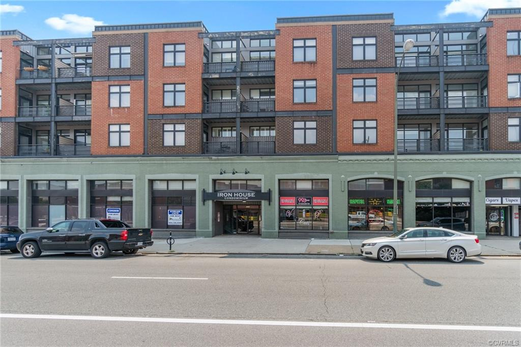 Welcome home to this two bedroom mid-century modern condominium at Ironhouse Place on Broad Street. This unit is completely renovated in turn-key condition. Noteworthy features include bamboo flooring, nine-foot ceilings, granite countertops, hard wood cabinetry, stainless steel appliances, ceramic tile in bathrooms, and private balcony. This quant condo unit invites you into an open concept kitchen, dining, and living-room area. This is one of the largest two bedroom units in the complex. Each bedroom features updated flooring. Primary bedroom features en-suite with full bathroom amenities. Washer and dryer available in unit. Newer Hot Water Heater. Basement storage available for rent. Secured garage parking with assigned unit. Ironhouse Condominiums are minutes away from VCU, MCV, Retail, Restaurants, and more. Monthly fee includes parking, water, trash, Direct TV, and wireless internet. Schedule a tour today!
