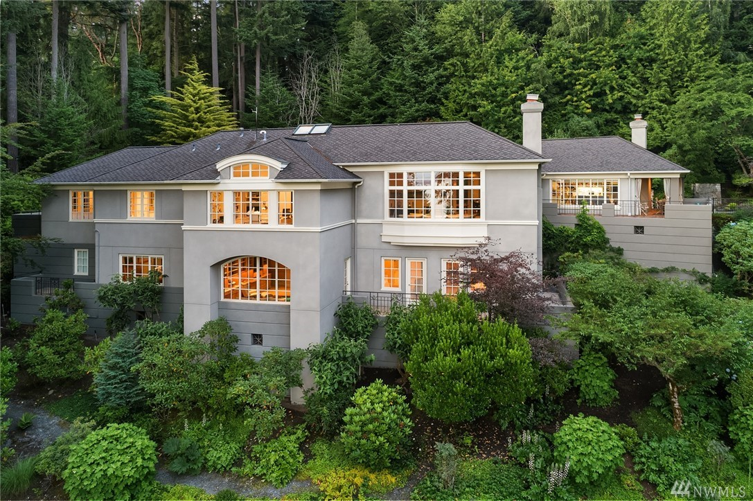 Gracious 5,510-sq-ft home, custom built in 1991 with abundant windows to bring in natural light and woodland setting. Interiors have high ceilings and fine detailing. Dramatic entry with skylight; lovely living room with fireplace and adjoining dining room; library;3 bedrooms; 3¾ baths. Expansive informal living space with chef's kitchen, eating area and family room with stone fireplace and terrace; adjoining room could be used as art studio or mudroom.Privately situated on 1.67-acre wooded lot.