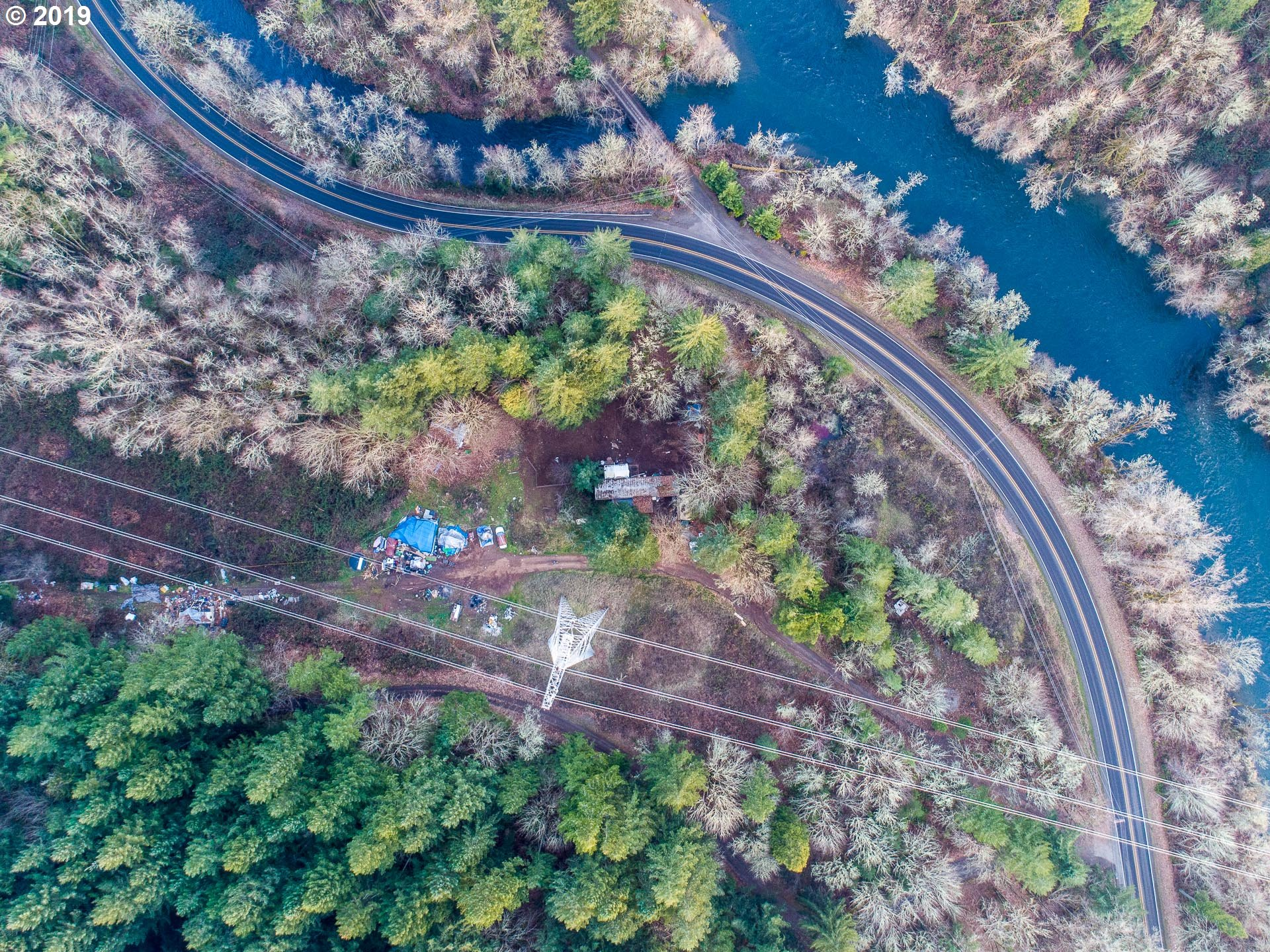 Nice property with River Views. Older 1984 single wide has little or no value. Nice building site at the top of the property. Build a new home or new manufactured and keep the other one for storage.