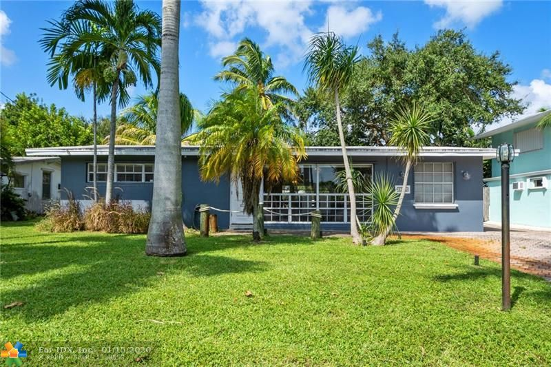 Do not miss this fantastic waterfront home! Located minutes from 595, Turnpike or 95, you can be in Miami or Boca in 30 minutes! Fifteen minutes to FLL! Boaters' neighborhood offers a community boat ramp minutes away. This lot features 65 feet of waterfront, deep water with no fixed bridges to the Intracoastal! Davits accommodate +/- 30' vessel out of the water, plus mooring whips for a smaller boat. The charming home features an open floor plan perfect for entertaining. Wood, granite and stainless Island kitchen boasts Kitchen-Aid and Miele appliances. Spacious Master Suite offers room for a King bed and a walk-in closet. Washer and Dryer inside the house! Vaulted ceilings, hurricane shutters and dual zone A/C. Large shed stores all of your tools and toys! Hurry!