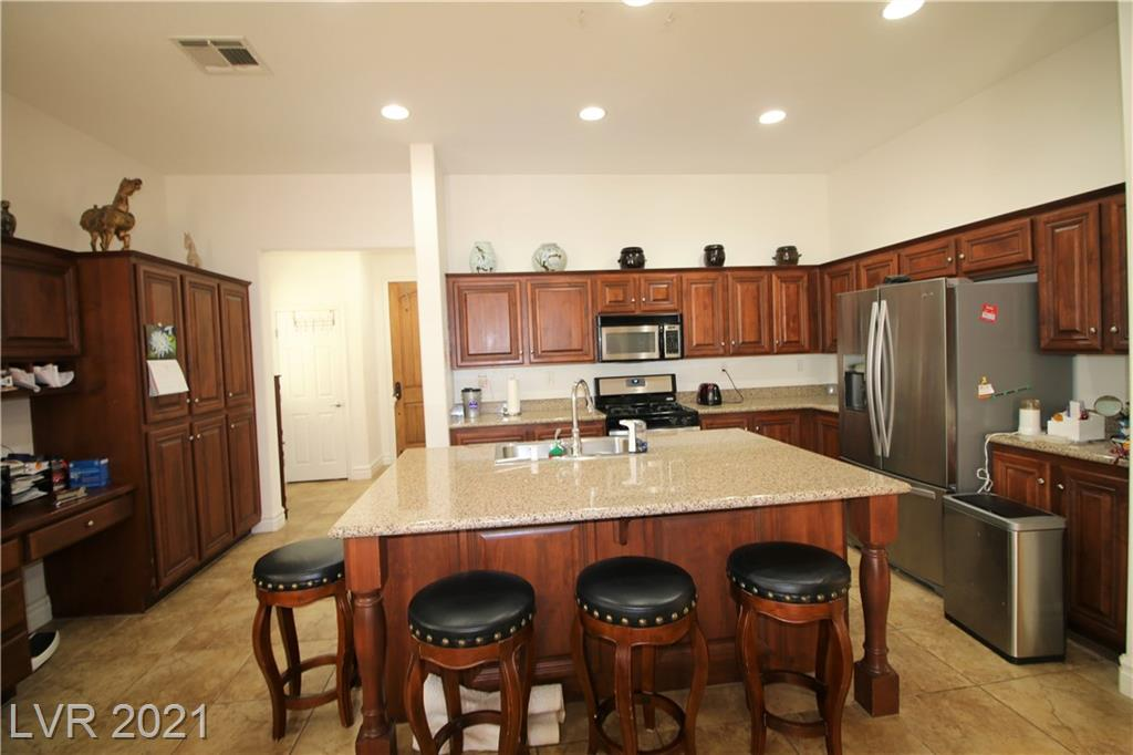 GUARD GATED GOLF COURSE COMMUNITY - MULTI-MILLION DOLLAR COMMUNITY CLUBHOUSE WITH POOLS. SPAS, BASKETBALL, RAQUETBALL, TENNIS COURTS, BILLIARDS ETC....  CASITA IS THE 4TH BEDROOM AND 3RD BATHROOM, MAIN HOUSE HAS ANOTHER 3 BEDROOMS AND 2 BATHS. FRONT OF HOME FACING GOLF COURSE. BUILDER PREMIUM FOR THE LOT WAS $35,000 BUT OWNER PAID 15,000 DUE TO PRIOR BUYER NOT QUALIFYING. NO HOUSES ACROSS STREET. BACKYARD IS A PARADISE. MATURE LANDSCAPE. TILE & NEW CARPET BEING INSTALLED. LAMINATE & TILE IN CASITA. LARGE MASTER BATHROOM W/SEPARATE TUB AND SHOWER, DOUBLE SINKS, & PRIVATE WATER CLOSSET . SPACIOUS WALK-IN CLOSET W/BUILT IN DRAWERS, SHELVES, & HANGING RODS. CEILING FANS & WINDOW SHUTTERS THROUGHOUT. LARGE KITCHEN, LOTS OF CABINTRY, GRANITE COUNTERS, OVERSIZED ISLAND, BUILT-IN MICROWAVE, STOVE, & FRIDGE. BUILT-IN DESK & ADDITIONAL STORAGE PERFECT FOR ANYONE WORKING FROM HOME. BAR SEATING INCLUDED. PERFECT FOR ENTERTAINING GUESTS. OPEN LIVING AREA W/FIREPLACE.