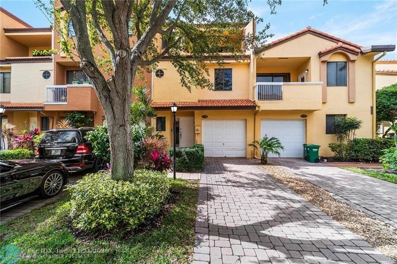 You don't want a high rise in Aventura but want the best schools and a family neighborhood? This tri-level townhome is perfect. Enter into a foyer, family room, kitchen & dining. Stainless appliances, open counter and huge back porch look into a garden area. Powder room downstairs. 1 car garage along with a 2 car driveway. Only 6 units have this deeded space! Walk upstairs and find the master bedroom with a balcony & renovated bathroom, along with a second en-suite bedroom. New full size washer/dryer on the second floor. Third floor has another large bedroom, balcony, skylight, bathroom and living area which is easily converted back to a 4th bedroom. Two AC units, one brand new. Roof 5 years. Gated with marina access, Maintenance includes Xfinity full, 2 DVR's, modem &high speed internet.
