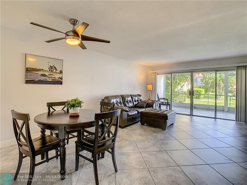 LIVE IN PRESTIGIOUS LIGHTHOUSE POINT AT AN AFFORDABLE PRICE. RARELY AVAILABLE SPACIOUS 2/2 CORNER GROUND FLOOR UNIT. BEAUTIFUL TILE THROUGH OUT. SCREENED PATIO OVERLOOKING GARDEN. ALL AGES WELCOME. WELL MANAGED COMMUNITY WITH RESERVES LOW HOA FEE'S. 2 HEATED POOLS. SHORT CAR RIDE OR BIKE TO BEACH. WALK TO GROCERY STORE, RESTAURANTS, LIBRARY, TENNIS CENTER AND PARKS. EXTRA LARGE STORAGE NEXT TO UNIT. NICE FURNITURE CAN BE INCLUDED. KITCHEN AND BATHS ORIGINAL BUT WELL MAINTAINED. NO PETS OR LEASING. CASH ONLY PER ASSOC.
