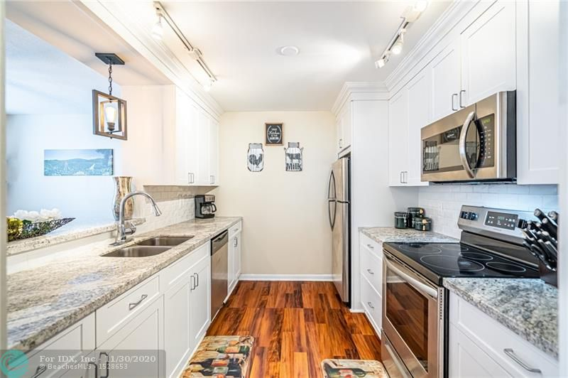 Updated end unit townhome with large backyard located 2 blocks from Wilton Drive. Property was redone in 2018 including new flooring, new bathrooms, new A/C, new kitchen appliances and fully fenced backyard. Half bath on first floor with 2 beds/2 baths upstairs. Community is pet friendly and unit has room to park 4 cars in the driveway. See link for 3D Virtual Tour.