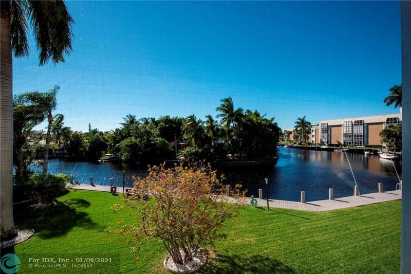 Fantastic direct water view at the rarely available River Bend condominiums on the waterfront. This is a 2-bedroom, 2- bath condo offering a panoramic river view! The home has a remodeled kitchen with granite counter tops. There is tile flooring in main living area and carpet in bedrooms  The 2nd bedroom has a custom built-in queen murphy bed with lighting and nightstand which converts from a home office/den to 2nd bedroom in seconds. Large screened balcony is accessible from the living room or master bedroom with en-suite bath. The master bedroom features a work area. A quick drive to the beach and Wilton Manors is just 3 minutes away. Large heated pool, club house, shuffle board & tennis court on 9 gorgeous acres of river front property.