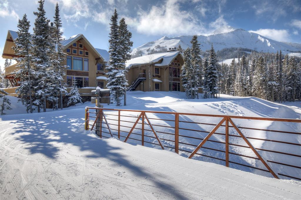 Superb ski-in, ski-out location for this 3 bedroom, 3.5 bath Luxury Suite. Open the door of this remarkable Luxury Suite and enter a world of rustic elegance and warmth. Marvel at the detail and care that was taken in making this a rare and exquisite Mountain retreat. Gorgeous hardwood floors and beautiful interior rock work add to the beauty of the gourmet kitchen and living area of this hard to find property. This 3 bedroom, 3 1/2 bath suite has plenty of open space to entertain family and friends. The designer baths with their slate and granite flooring and countertops add to the overall beauty of this home. In additional to all of this, enjoy ski-in, ski-out access to the slopes both Moonlight Basin and spectacular views of the Spanish Peaks.