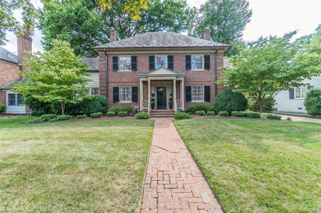 Welcome to this masterpiece of architecture and design on Riverside Drive, just steps to the James River and minutes to Carytown, the Fan, and downtown.  Built in 1946 and renovated from top to bottom, it will please the most discerning buyer.  The statuesque brick & slate exterior is the perfect introduction to the exquisite details inside.  Gracious formal rooms with large windows, tall ceilings, and hardwood floors offer period charm while recent improvements make the home more functional and even greater for entertaining.  A major renovation in 2018 included a two-story addition with a new family room off the remodeled kitchen, as well as a master bedroom suite – all with high-end finishes.  In addition to the four spacious bedrooms on the second floor, there are two additional rooms that can work as home offices/classrooms. Also if needed, the sunlit first floor room off the living room could serve as the same! Enjoy outdoor entertaining on the screened in porch or fenced in back yard with patio. Other features include an unfinished basement with new built-in shelving, and a work bench with sink. Additional storage in detached three-car garage and pull-down attic.