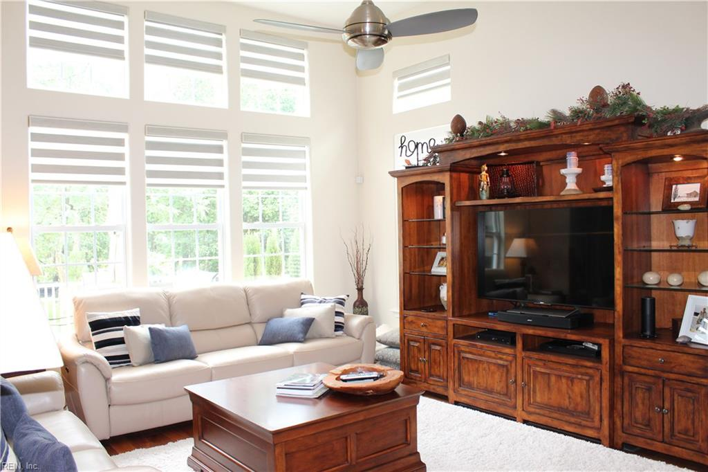 Great room showing the remote-controlled custom window shades.