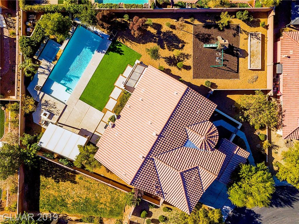 OVER 1/4 ACRE LOT*POOL/SPA/3 FIRE PITS*BUILT IN BBQ*PLAYGROUND AND GARDEN AREA ON SIDE YARD*BED & BATH DOWNSTAIRS*HUGE LOFT UPSTAIRS*OFFICE DOWNSTAIRS*GATED COMMUNITY*VERY OPEN FLOOR PLAN*MARBLE FLOORING THROUGHOUT*GOURMET KITCHEN WITH SS APPLIANCES & GRANITE COUNTER TOPS*HUGE 19X17 MASTER BEDROOM*FORMAL DINING ROOM*HUGE LOFT UPSTAIRS 28X13*18FT CEILINGS*POOL MEASURES 40X14*BACK YARD IS 90X55 & SIDE YARD 63X40*IRON & WOOD STAIR RAILINGS*