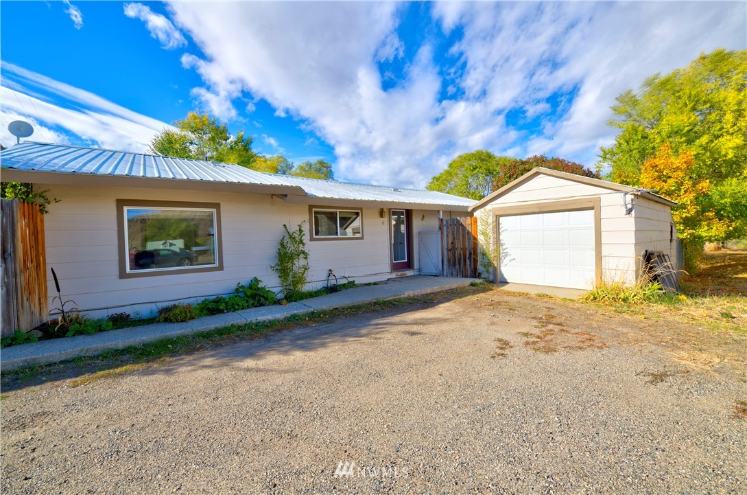Twisp 2 bd 1 bth home with fenced yard, and fenced garden area too.  Large outdoor deck to enjoy the secluded yard. Detached 1 car garage, wood shed, and outbuilding for additional storage. Private 60 gpm well to water large fenced yard with no additional meter bill from the city! The location is outstanding, right next to the Twisp Grange and minutes from core downtown Twisp, the Merc Playhouse, Hank's Market, Twisp Farmers Market, Cinnamon Twisp Bakery, Glover Street Market and more.