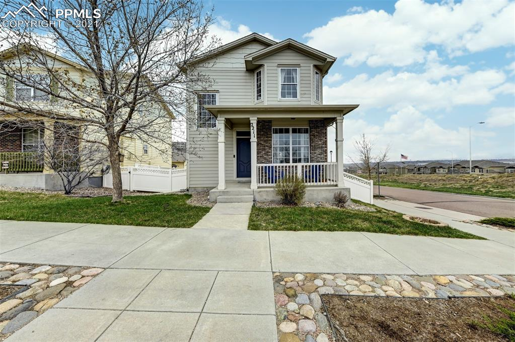 This alluring 2-story home is located on a corner lot with incredible views of the entire front range* It is located in an established community with easy access to downtown, military bases, a community park, schools, shopping, and more* This home has great curb appeal with low maintenance landscaping and a charming covered front porch* As you step inside, you will notice the bright and open floor plan* The Living Room has large windows that allow natural light to pour into the home and has breathtaking mountain views* The Kitchen features ample cabinet and countertop space, a counter bar with seating, and staggered cabinets* The Dining Room is just off of the Kitchen and has a walk-out* The Family Room has a cozy gas fireplace for those Chilly Colorado nights with a built-in media niche above it* There is a Laundry Room and 1/2 Bath on the main level for added convenience* Upstairs you have the Master Bedroom with vaulted ceilings, an adjoining full Bath, and a walk-in closet* There are 2 additional Bedrooms and a full Bath also upstairs* The finished basement has a Rec Room, 4th Bedroom, and full Bath* This home has central air to enjoy on the hot summer days to come* The Backyard is fully fenced with an over-sized 2 car detached garage with alley access*