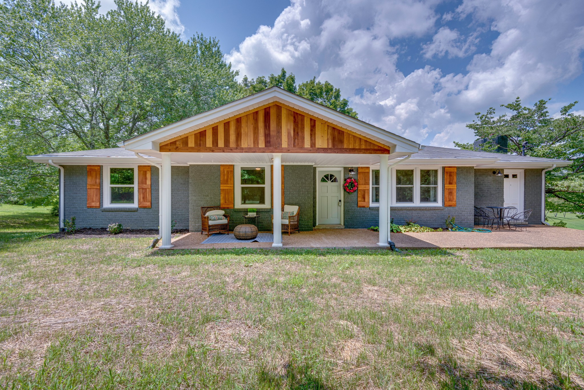Distinctively updated Fairview home* This home sits on a beautiful shaded 1 acre lot*  Finished hardwood floors throughout*  All new stainless steel appliances* QUARTZITE countertops* DOUBLE MASTER VANITY* Large front porch to enjoy the beautiful Tennessee weather*