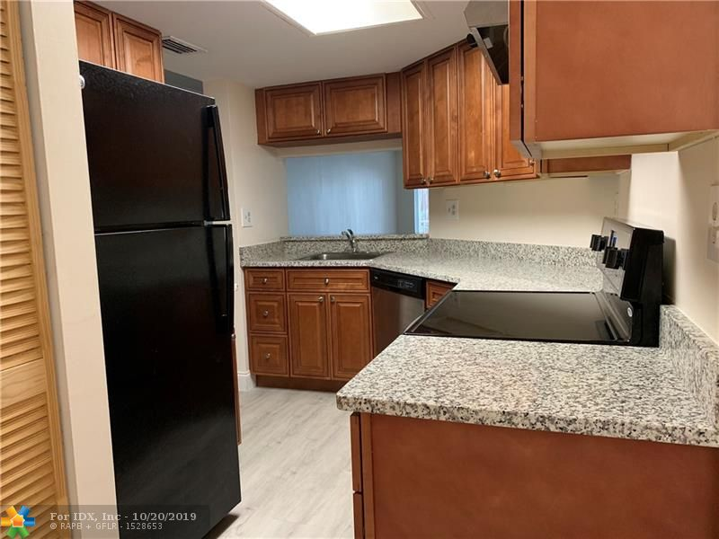INVESTOR'S DREAM! SPACIOUS AND RENOVATED 2 bed 2 bath ground floor unit with beautiful lake view. Washer and dryer are inside the unit. Unit has separate storage room and rare 2 parking spaces. Amenities include pool, hot tab, exercise room. Great location: close to shopping plazas, restaurants, banks, casino, golf course, I-95 and Turnpike. Only 5 miles to beach.  Tenant occupied till 05-31-20.