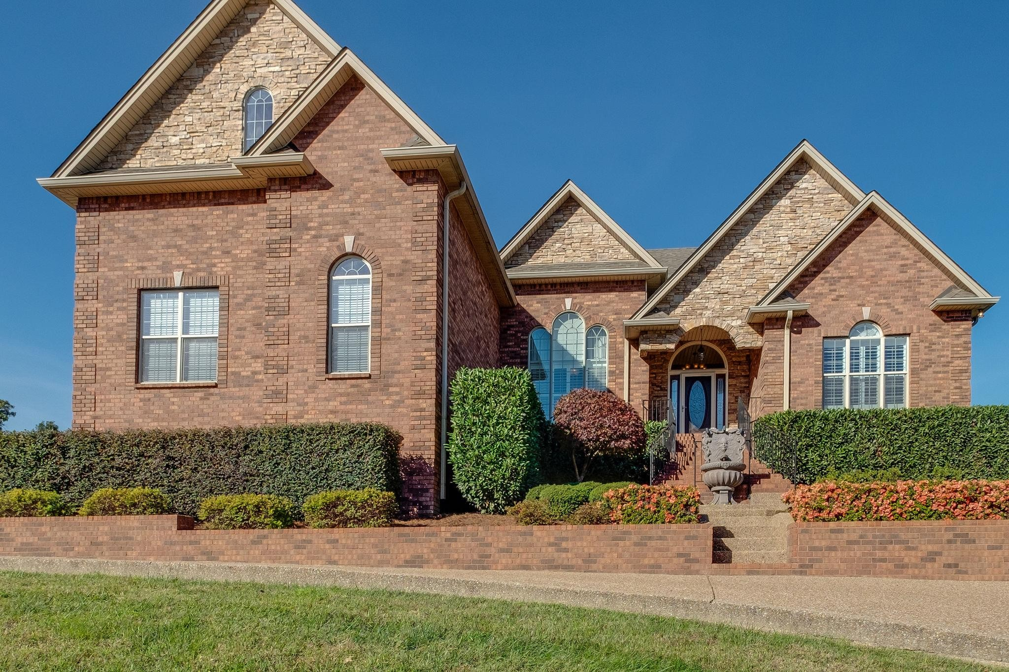 Gorgeous home! Quite Culdesac One level w/bonus up 20' ceiling in great room! Amazing master suite with stacked stone fireplace! Beautiful hardwoods! Kitchen and eat in area overlooks private back yard with awesome pool and covered patio, along w/outdoor kitchen! To top it all off - His and Her separate garages!