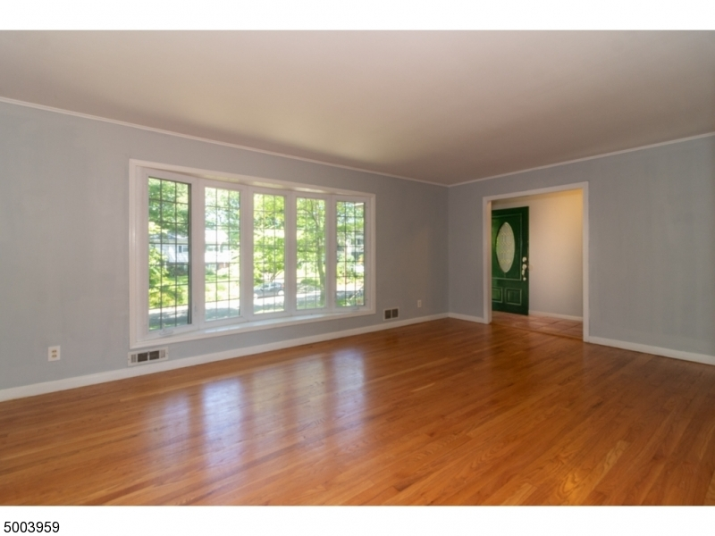 Great value IN this large .0486 acre property raised ranch. Great schools close TO NYC public transportation.