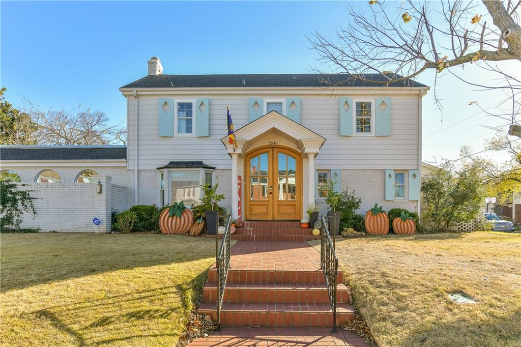 Check out this stunning remodel in the coveted Cleveland neighborhood. This home was completely remodeled a few years back and boy did they not miss a thing! From the street, the home is a complete show stopper! This stunning colonial sits on FOUR city lots with a detached garage. The garage has plenty of parking and storage and is even plumbed for a bathroom. Inside the home, there is so much room for entertaining. The sun room is beyond amazing with a room full of windows for tons of natural light and a wood burning fireplace and wetbar with stunning refinished chandeliers. The downstairs master has fabulous vaulted ceilings and wood beams, walk in closet and gorgeous ensuite. There's a spacious 730 sqft basement with a bathroom and is great for hanging out (Not included in the square footage). Upstairs you'll find 3 large bedrooms with cedar closets and loads of natural light. There is certainly not enough room to write  it all out. You must come and see it!