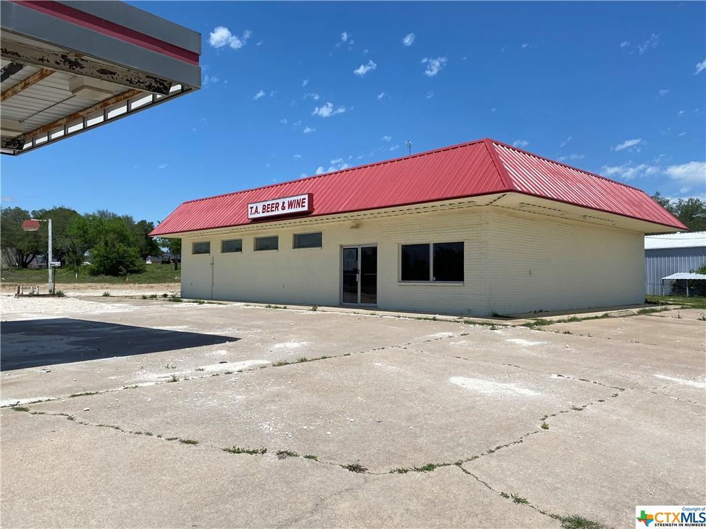 Commercial Property for Sale in Central Texas.  This central location is right on Hwy 36 with 340 + feet of highway frontage. This commercial building for lease has been recently updated with new floors and fresh paint n the inside and outside. There are coolers in place and space for a small commercial kitchen. The inside is large and open and leaves room for retail and space for tables if the kitchen is in use. This commercial building for sale has more land available.  This retail space has the potential to be a must-stop place for travelers. There is covered parking in front as well as space for signage with high visibility.  The gas tanks have been removed. With a little vision this could be a very profitable commercial investment for a car dealership, restaurant, supply store, retail storefront, or anything else you can dream up. Adjacent commercial property is also for sale if you need more space.
