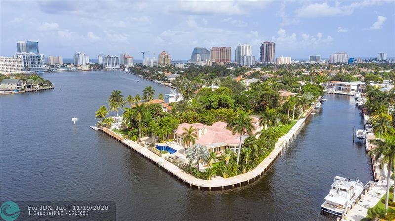 Super-Yacht Haven: Simply Unique. Nothing like this beautifully landscaped point lot in Las Olas. 550' of deep protected waterfront on 1.14 secluded acres located on the most desired street in Las Olas and on the wide and tranquil Rio Barcelona, named by Ponce de Leon. Includes separate building lot with lighted tennis court. Gated entry with long driveway leads to circular covered entrance to the home. Almost 10,000 square feet of European style elegance. Soaring ceilings and large fireplace grace the great room and the warm family room with bar and billiards area. Outside is a semi-enclosed lounge and outdoor dining area overlooking the water and gardens. The kitchen is designed for a professional chef.  The huge first floor master suite and a private office open to the pool.