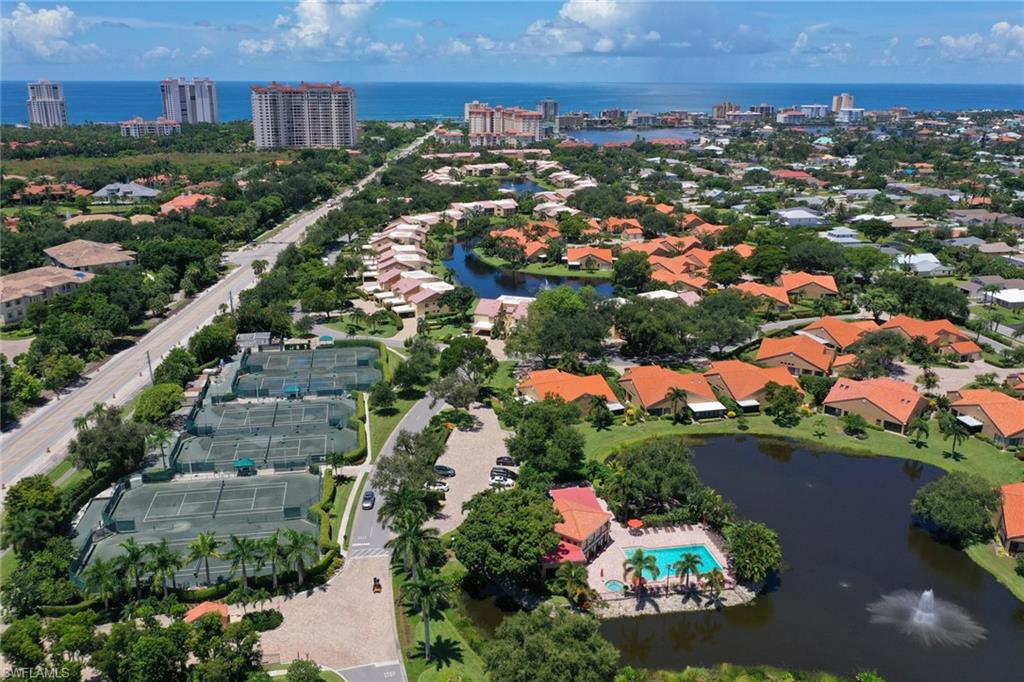 Located in the gated, pet friendly community of Beachwalk you'll enjoy calming lake views & warm Florida breezes from the screened lanai of this lovely second floor condo. An ideal winter getaway or investment property, this unit is offered TURNKEY furnished, has a great rental policy and is just a few steps from one of two community pools. The layout features large rooms, high ceilings, terrific walk-in closets & covered parking! Relax & enjoy the serenity of the lake with its night-lighted large fountain. Beachwalk is a low-density community of winding roads & lush tropical foliage ideally located West of 41 & appropriately named for its stellar location just one mile to the sparkling white sands of Vanderbilt Beach. Community amenities include clubhouse, fitness center, two pools, 6 Har-tru tennis courts, bocce courts, 24-hour guard gated entry, onsite manager and more. Walk to adjacent shopping, park, public library, movies, gym and the elegant Mercato with its large array of shopping and fine dining options! Best of all, west of 41, you're just a quick walk to Vanderbilt Beach where you'll enjoy morning strolls and evening sunsets! Come enjoy your piece of paradise!