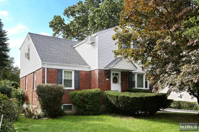 Welcome home to this updated 3 Bd/ 2.5 BA Colonial style home that will surpass your expectations. Walk into a large bright living room, large formal dining room, eat in kitchen w/ silestone counters and stainless appliances, sliders that lead to a nice size deck overlooking the backyard, full bath and home office completes the first floor. 2nd floor consists of three spacious bedrooms including a large primary bedroom with great space including an oversized closet. Full basement with laundry, utilities, 1/2 a bath and large enough to be finished for a game room, movie room, or additional living space. Detached 1.5 car garage, Hardwood floors, brand new roof, close proximity to elementary school, shops, restaurants and NYC transportation.
