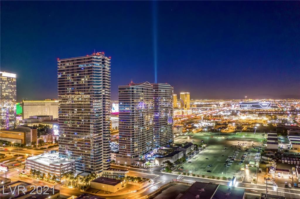 """High Rise Living at its finest! Amazing views of the Las Vegas Strip, City Center, Allegiant Stadium which all say """"location, location, location"""". Walking distance to City Center, the Strip, Allegiant Stadium (so close you can see the torch when it's lit), much, much more! This unit has been completely remodeled with high-end finishes: stainless steel appliances, quartz counters, wood and porcelain flooring, motorized shades, custom cabinetry, dry bar, drop soffit with recessed lighting, absolutely stunning. The fitness center, business center, conference room, indoor spa, outside pool w/cabanas are all spectacular. If you are looking for the perfect Las Vegas address, this is it!"""