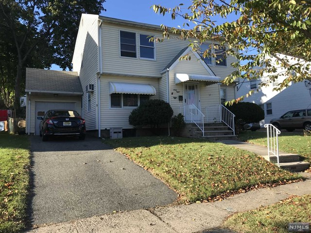 Cape Cod on quiet street features front foyer, living room, EIK, two bedrooms, full bath and porch on first floor.   1st floor bedroom was being used as dining room.   2nd floor features four bedrooms and full bath.   Convenient to public transportation and shopping.