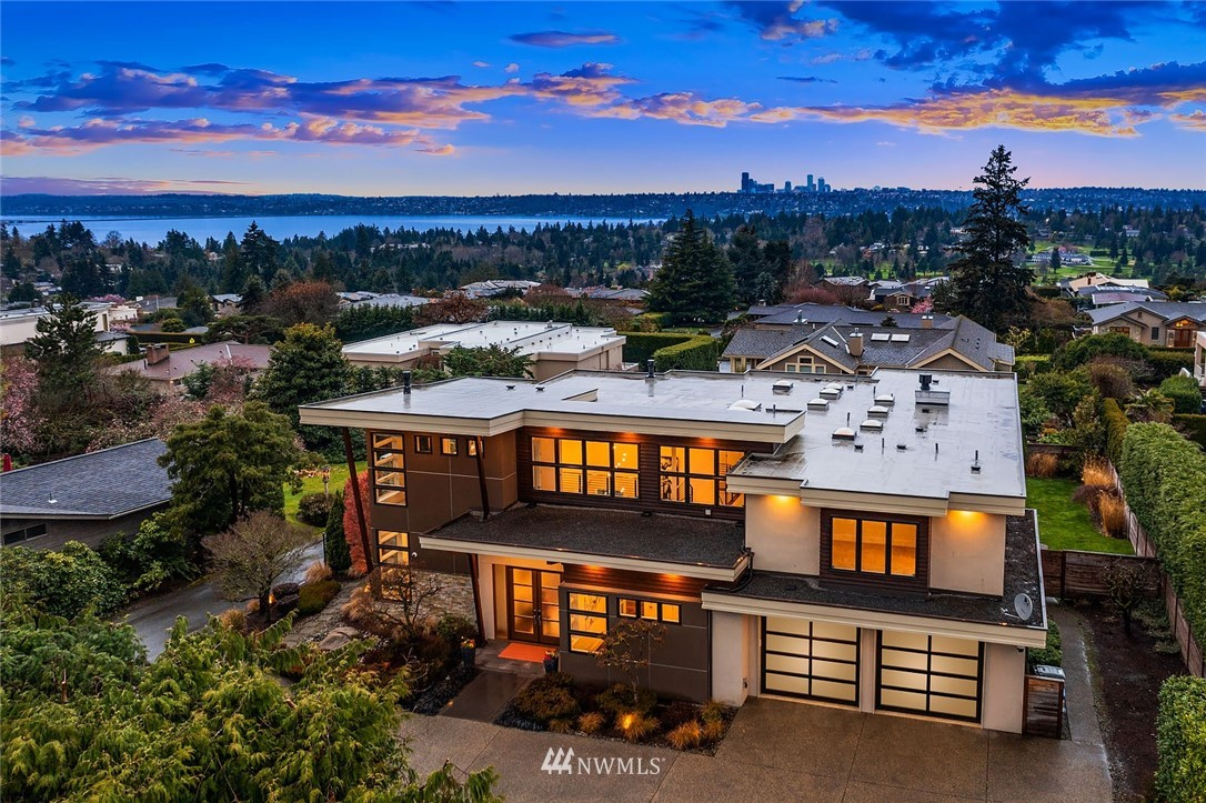 Located at the end of a private lane, this stunning modern masterpiece was designed by 4D Architects & built by Adam Leland. Clean lines & walls of windows reveal magnificent views of Lk Washington, Seattle skyline & snow-capped Olympic Mtns. Ideal for entertaining, the main floor flows effortlessly & extends to the covered patio with gas fireplace & overhead heater for year-round enjoyment. Spacious quartz kitchen with high-end appliances. The 2nd floor provides a perfect escape with bonus room, luxurious view master & 3 additional bedrooms. Main floor den/5th BR with closet. Gorgeous landscaped grounds feature a level, fenced yard, huge patio and pool - your personal oasis. Sophisticated HVAC installed in 2018. Elaborate security system.