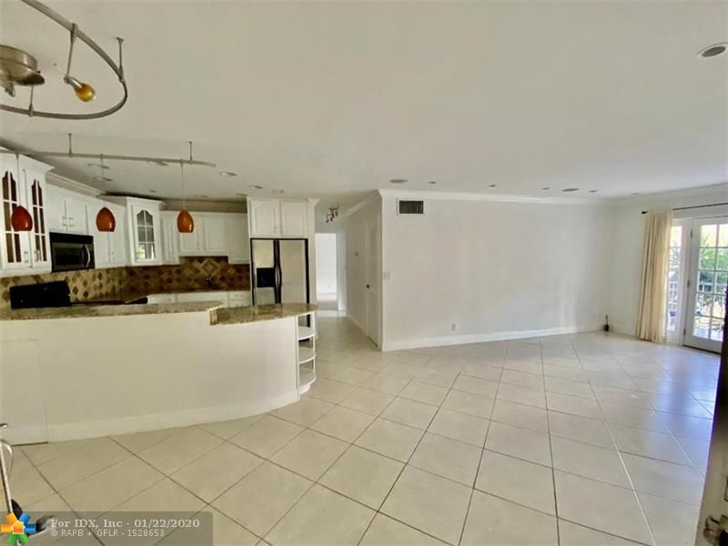 PERFECT STAYCATION ... BOATER'S DREAM!! Enter this MUCH SOUGHT AFTER condo community through the security guard gate. Located in the heart of Fort Lauderdale is this newly renovated 2 bedroom, 2 bath unit. Kitchen w/granite counters, stainless steel appliances and wine fridge opens to dining room and huge living room. Master bedroom w/bath offers a w/in custom closet. 2nd bedroom w/custom closet, a hall bath and screened in patio / balcony round off this stunningly renovated condo. Washer and Dryer in the unit. Amenities include multiple Pools and club houses, 6 tennis courts, 24 hour gated security, canals w/boat docks $1.50/ft/M dockage fee, etc, etc,...