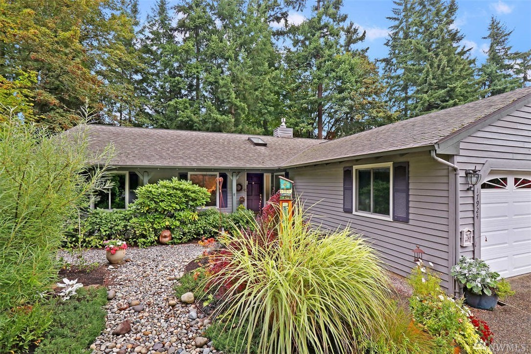 A well-maintained home surrounded by a verdant garden with lush landscaping outside every window. Find all the right spaces with 3 tranquil bedrooms, including a master suite.  Beyond the bedrooms are an oversized family room warmed by a fireplace off the kitchen. There's also a formal dining room and living room. The private back deck offers a peaceful setting among the ferns and dahlias to recharge or entertain. Two-car garage. Tons of storage. Big shed. Superb schools, near MSFT.