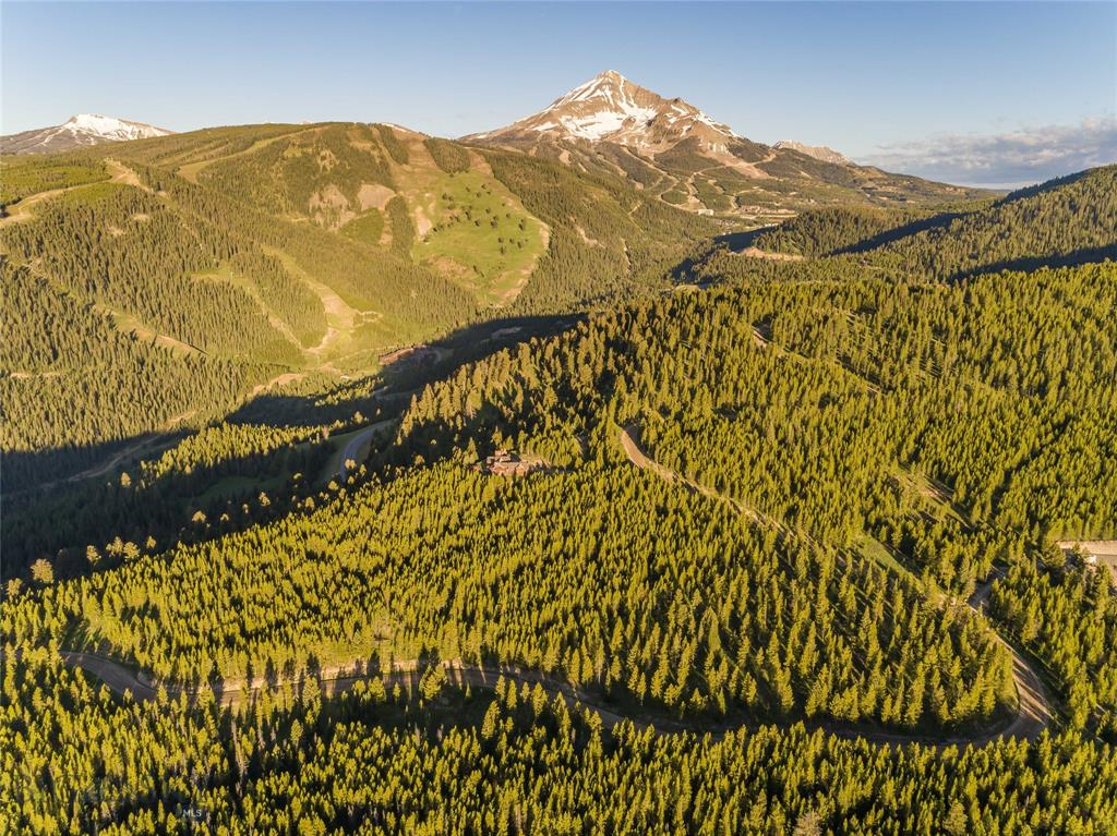 This 20-acre parcel includes several incredible view options based on chosen building site location including Spanish Peaks, Lone Mountain, and the Big Sky valley. The gently sloping lot has Southern and Eastern exposure while enjoying privacy, abundant wildlife viewing, nearby access to Lee Metcalf Wilderness and Gallatin National Forest, and is just minutes from Town Center and Big Sky Resort. Ski-in/ski-out on Lone Mountain Ranch XC trails that cross the corner of the property and wind through Lost Trails, connecting residents to dozens of miles of groomed trails. The region is renowned for enjoying the outdoor life, including the Gallatin National Forest, Yellowstone National Park, and top notch fishing, hunting and more. Lost Trails owners share a community water system, and electricity is underground to the lot. Don't miss this special opportunity to build your Montana dream in a private, quiet setting, while being close to all of the area's amenities.